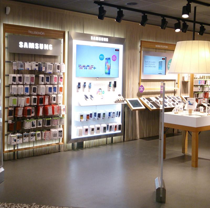 Telia. Ställ för mobiltelefoner etc. LED används för att framhäva produkter på bästa sätt.